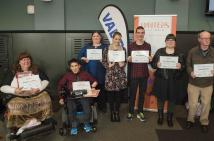 seven people facing camera holding their certificates from the Dulcie Stone Competition