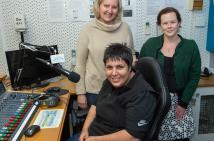 Moe Peer Action Group members sitting in radio studio.