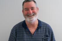 Portrait of Mark Thompson, Community Educator, smiling at the camera