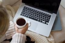 woman sitting at laptop working on NDIS plan
