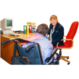 Advocate sitting with client at desk