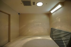 photo bare prison cell with only a mattress
